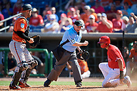 Home plate umpire Tom Hallion calls Lane Adams (18) out on a play at the plate after being tagged by Baltimore Orioles catcher Austin Wynns (61) during a Grapefruit League Spring Training game against the Philadelphia Phillies on February 28, 2019 at Spectrum Field in Clearwater, Florida.  Orioles tied the Phillies 5-5.  (Mike Janes/Four Seam Images)