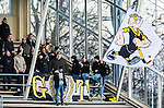 Uppsala 2015-02-28 Bandy Elitseriekval IK Sirius - Gripen Trollh&auml;ttan BK :  <br /> Gripen Trollh&auml;ttans supportrar med en flagga under matchen mellan IK Sirius och Gripen Trollh&auml;ttan BK <br /> (Foto: Kenta J&ouml;nsson) Nyckelord:  Bandy Elitserien Elitseriekval Kval Kvalserien Uppsala Studenternas IP IK Sirius IKS Gripen Trollh&auml;ttan supporter fans publik supporters