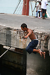 CHILD JUMPS IN WATER OFF PIER