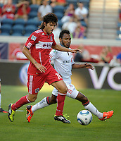 Chicago midfielder Sebastian Grazzini (10) prepares to shoot while being defended by Toronto midfielder Julian de Guzman (6).  The Chicago Fire defeated Toronto FC 2-0 at Toyota Park in Bridgeview, IL on August 21, 2011.