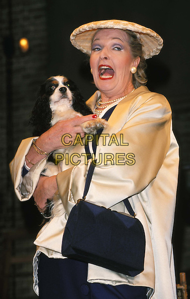 PENELOPE KEITH.Ref:11166.stage, theatre, dog, costume, singing, half length, half-length.*RAW SCAN - photo will be adjusted for publication*.www.capitalpictures.com.sales@capitalpictures.com.© Capital Pictures