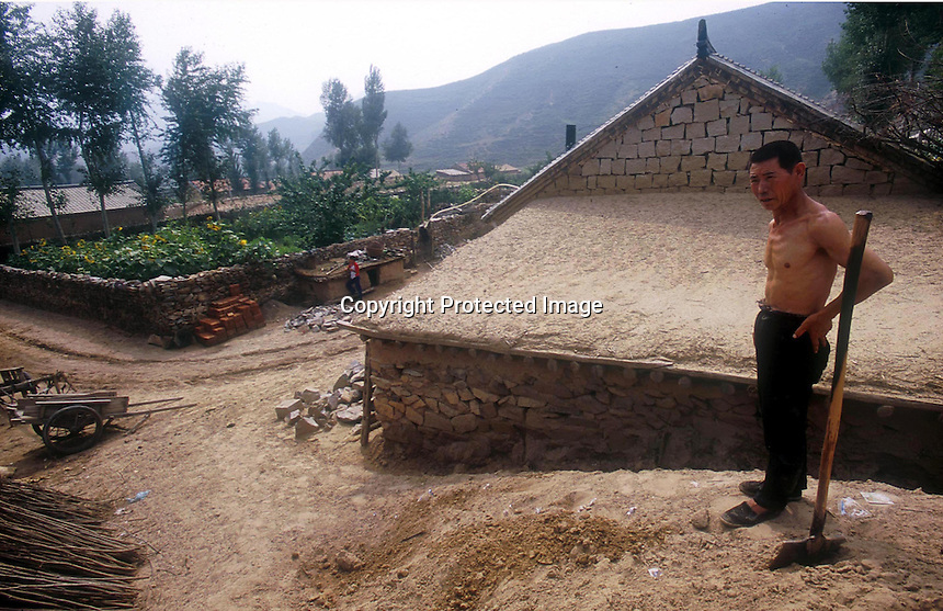 Moving sand swamps a village house despite the efforts of locals to dig it out in LangTou Gou, Fang Ning, China.  Droughts and increasing desertification are the causing ever-greater environmental problems in northern China...PHOTO BY WONG  / SINOPIX