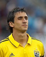Columbus Crew midfielder Milovan Mirosevic (10). In a Major League Soccer (MLS) match, the New England Revolution tied the Columbus Crew, 0-0, at Gillette Stadium on June 16, 2012.