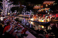 A barge floats down the San Antonio River during the Ford Holiday River Parade, Friday, Nov. 25, 2011, on the Riverwalk in Downtown San Antonio, Texas. (Darren Abate/VisitSanAntonio.com)