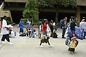 People gather at the Louisiana Superdome Sunday afternoon for shelter during Hurricane Katrina .<br />