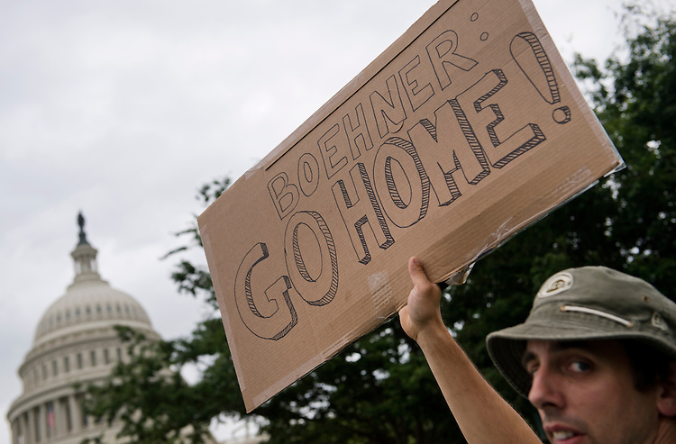 UNITED STATES - JUNE 19: A man from Kentucky attends a Tea Party Patriots rally on the west front of the Capitol to protest the IRS's targeting of conservative political groups. (Photo By Tom Williams/CQ Roll Call)