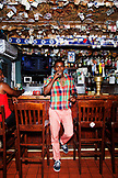 BERMUDA. Chef Marcus Samuelsson having the famous Rum Swizzle at the Swizzle Inn at Bailey's Bay.