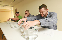 NWA Democrat-Gazette/FLIP PUTTHOFF <br /> WATER TASTING CHAMPIONSHIP<br /> Nathan Miles (from left), Matt Walters and Ben Kennedy judge water samples on Wednesday March 13 2019 from Northwest Arkansas water providers during the annual best-tasting water contest in Rogers. Springdale Water Utilities won the contest to reign as 2019 water tasting champions. Water tasting drama unfolded when Springdale and Bella Vista Water Department tied for first. Springale emerged the winner in a sip-off. Tap water was judged on taste, color, clarity and odor, said Zak Johnston, contest coordinator with Washington Water Authority.  The contest was held at the Center for Nonprofits in Rogers during the monthly meeting of the Northwest District of the Arkansas Waterworks and Water Environment Association. Springdale water advances to the state water-tasting championship in May during the association's state meeting in Hot Springs.