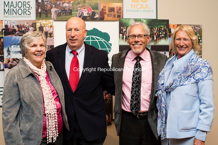WATERBURY, CT- 20 November 2015-112015EC13-  Social Moments. The Mattatuck Museum in Waterbury hosted an opening for several art exhibitions spanning each floor of the building. From L to R: Sandy Post, Gary Post, and Post University's Dr. Don Mroz and Susan Lapine. Erin Covey Republican-American