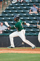 K.J. Woods (32) of the Greensboro Grasshoppers follows through on his swing against the Hickory Crawdads at L.P. Frans Stadium on May 6, 2015 in Hickory, North Carolina.  The Crawdads defeated the Grasshoppers 1-0.  (Brian Westerholt/Four Seam Images)