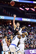 Washington, DC - MAR 11, 2018:Davidson Wildcats guard Jon Axel Gudmundsson (3) shoots over two Rhode Island Rams defenders E.C. Matthews (0) and Cyril Langevine (10) during the Atlantic 10 men's basketball championship between Davidson and Rhode Island at the Capital One Arena in Washington, DC. (Photo by Phil Peters/Media Images International)