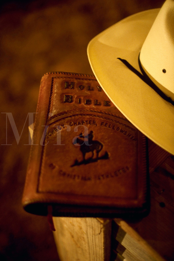 A cowboy hat and bible at a rodeo church. Texas.