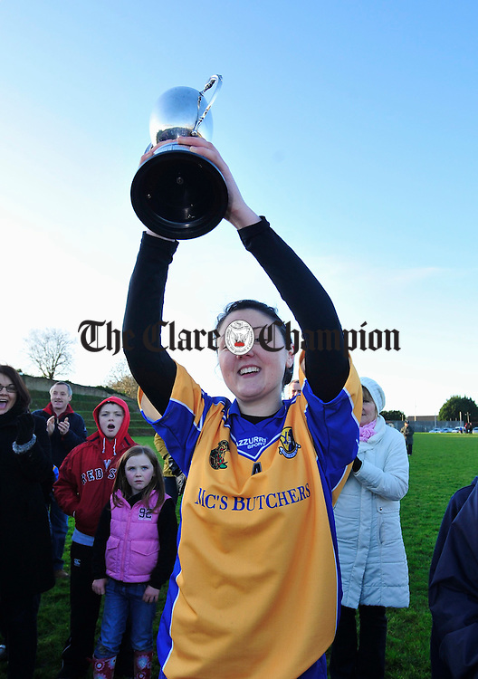 Sixmilebridge Captain Katie Connor lifts the trophy. Photograph by Declan Monaghan