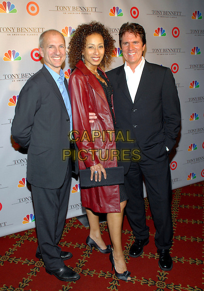 "JOHN DeLUCA, TAMARA TUNIE & ROB MARSHALL.Premiere screening of ""Tony Bennett: An American Classic"", New York, NY, USA..November 15th, 2006.Ref: ADM/PH.full length black red jacket suit grey gray clutch purse.www.capitalpictures.com.sales@capitalpictures.com.©Paul Hawthorne/AdMedia/Capital Pictures. *** Local Caption ***"