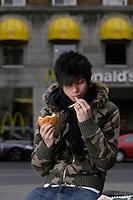 Montreal (Qc) CANADA -Nov  2007- MOdel Released photo of a 17 year old half Canadian - half Vietnamese emo teenager<br /> <br /> <br /> <br /> <br />   eating junk food