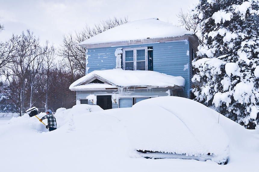 A resident of Bradshaw Nebraska digs out after a vicious Christmas day blizzard in 2009.