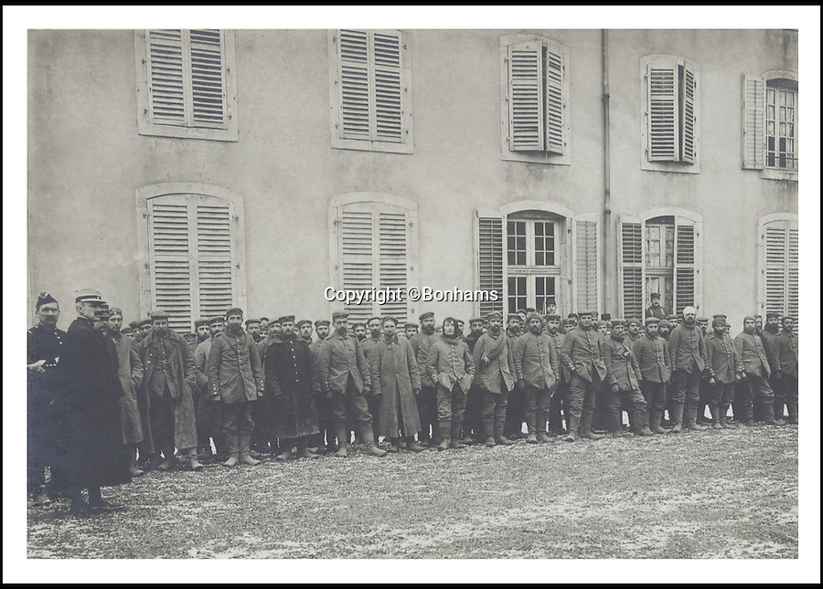 BNPS.co.uk (01202 558833)<br /> Pic: Bonhams/BNPS<br /> <br /> ***Please Use Full Byline***<br /> <br /> German prisoners of war, France, 1915. Taken by Prince Edward VIII.<br /> <br /> <br /> <br /> <br /> A remarkable album of photographs taken by the future King Edward VIII during a 'sight seeing' tour of the Western Front 99 years ago has come to light.<br /> <br /> Edward, Prince of Wales, took his own camera with him on his morale-boosting visit to the front-line in France in 1915.<br /> <br /> The young Royal took scores of snaps which included a gang of captured German soldiers, shell holes, bomb damaged buildings and British troops practising throwing hand grenades.<br /> <br /> He also snapped numerous Army officers he met on the visit and posed for several photos as well.