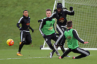 SWANSEA, WALES - JANUARY 28: Marvin Emnes avoids two opponents during the Swansea City Training Session on January 28, 2016 in Swansea, Wales.