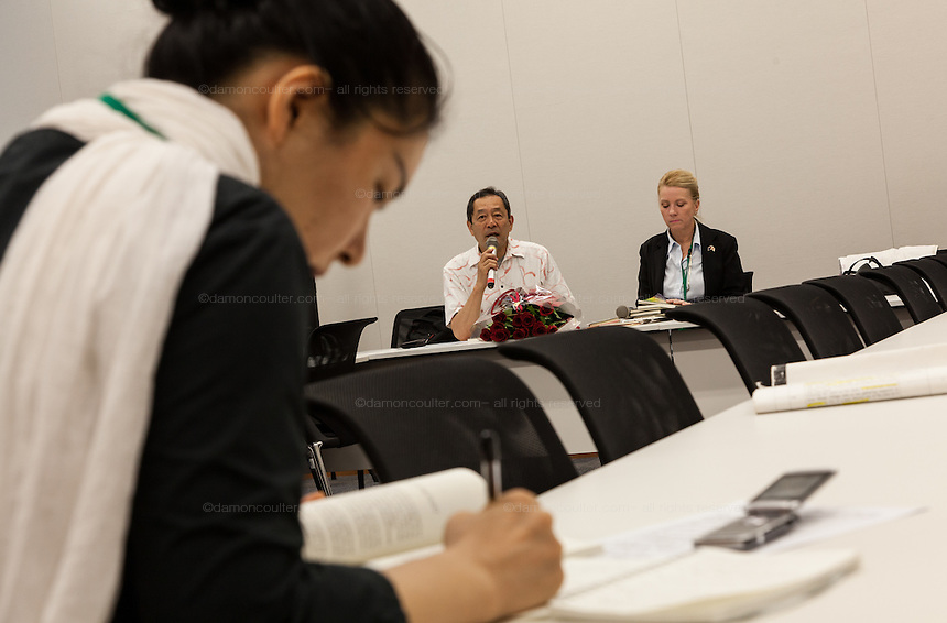 """Rape Survivor and activist, Catherine """"Jane"""" Fisher (right) with ex SDP politician, Ryoichi Hattori (left) at a press conference to publicise her book  in the First Office Building of the Members of the House of Representatives, Nagatacho, Tokyo, Japan, Friday July 18th 2014. Ms Fisher was raped near Yokosuka US Naval Base in Kanagawa in 2002 and has been campaign for the rights of rape victims in Japan since after finding the US Military and Japanese police obstructive and uninterested in bringing her attacker to justice."""