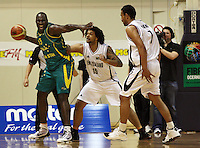 Boomers forward Nathan Jawai is pressured by BJ Anthony during the International basketball match between the NZ Tall Blacks and Australian Boomers at TSB Bank Arena, Wellington, New Zealand on 25 August 2009. Photo: Dave Lintott / lintottphoto.co.nz