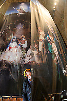 BNPS.co.uk (01202 558833)<br /> Pic: ZacharyCulpin/BNPS<br /> <br /> Pictured: Falling angel - Photographer Ash Mills admires the nativity.<br /> <br /> One of the UK's most historic cathedrals today unveiled a 40ft Renaissance-style photographic tableau as its nativity - with its very own clergy, volunteers and staff starring as figures from the Christian scene.<br /> <br /> Salisbury Cathedral's spectacular nativity features its stonemason as Joseph, a bookings agent as Mary, a retired postman as a shepherd, a Canon and guides as Wise Men - and the son of an ex-England rugby player as baby Jesus.<br /> <br /> The Wiltshire cathedral wanted to put a modern twist on the traditional Christmas scene and cast people as Nativity characters before holding a series of individual and group photoshoots.