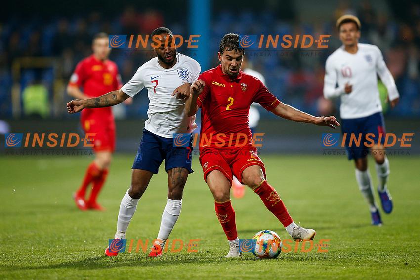 Raheem Sterling of England and Filip Stojkovic of Montenegro  <br /> Podgorica 25-3-2019 <br /> Football Euro2020 Qualification Montenegro - England <br /> Foto Daniel Chesterton / PHC / Insidefoto <br /> ITALY ONLY