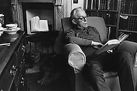 Michael Foot, Labour politician, reading at home.  1970s.