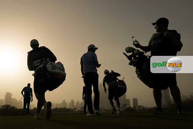 Caddies and a group leave the 8th tee during the first round of the Omega Dubai Desert Classic, Emirates Golf Club, Dubai, UAE. 24/01/2019<br /> Picture: Golffile | Phil Inglis<br /> <br /> <br /> All photo usage must carry mandatory copyright credit (© Golffile | Phil Inglis)
