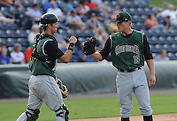 Catcher Jeff Arnold (20) of the Augusta GreenJackets, left, congratulates pitcher Steven Neff (19) after the final out in a game against the Greenville Drive on August 22, 2012, at Fluor Field at the West End in Greenville, South Carolina. Augusta won, 6-1. (Tom Priddy/Four Seam Images)