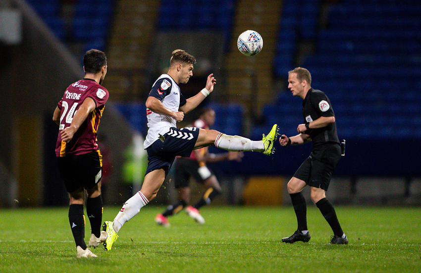 Bolton Wanderers' Dennis Politic (centre) competing with Bradford City's Danny Devine <br /> <br /> Photographer Andrew Kearns/CameraSport<br /> <br /> EFL Leasing.com Trophy - Northern Section - Group F - Bolton Wanderers v Bradford City -  Tuesday 3rd September 2019 - University of Bolton Stadium - Bolton<br />  <br /> World Copyright © 2018 CameraSport. All rights reserved. 43 Linden Ave. Countesthorpe. Leicester. England. LE8 5PG - Tel: +44 (0) 116 277 4147 - admin@camerasport.com - www.camerasport.com