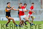 Barry O' Sullivan Dingle in action against Joseph O'Connor and Dylan Casey  Austin Stacks in the Quarter Final of the Kerry Senior Football Championship between Austin Stacks and Dingle at Austin Stack Park on Saturday night