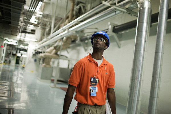 August 20, 2009. New Hill, North Carolina.. At Shearon Harris nuclear power plant,  Tim Baldwin is one of a few employees, called the fire watch, whose one job is to smell for smoke and look for fire. Baldwin walks the miles of corridors and stairwells inside the plant as a final precaution to ensure the safety of the plant and the surrounding communities.. Here Baldwin checks for problems within the Reactor Auxiliary Building.. ..