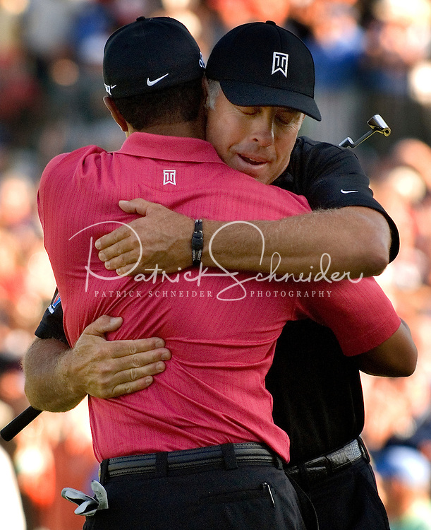 PGA golfer Tiger Woods hugs caddie Steve Williams after winning the 2007 Wachovia Championships at Quail Hollow Country Club in Charlotte, NC.