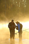 MAN AND WOMAN STEELHEAD FLY FISHING ON THE CATTARAUGUS RIVER