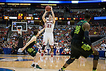 Wisconsin Badgers guard Josh Gasser (21) shoots a 3-pointer during  a regional semifinal NCAA college basketball tournament game against the Baylor Bears Thursday, March 27, 2014 in Anaheim, California. The Badgers won 69-52. (Photo by David Stluka)