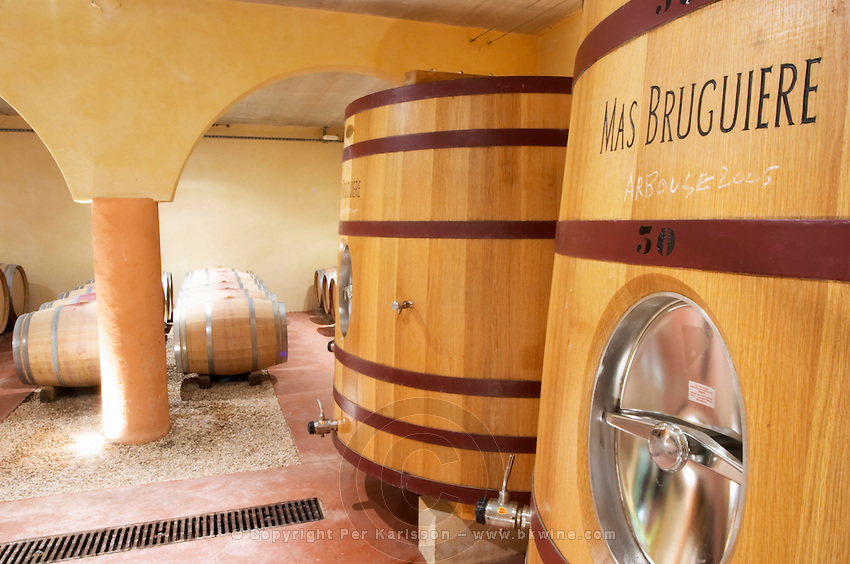 Domaine Mas Bruguiere. Pic St Loup. Languedoc. Barrel cellar. Wooden fermentation and storage tanks. France. Europe.