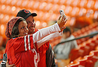Hamilton, Ohio native Lisette Pate converted her Florida friend , Domenic Camarda into a Buckeye fan as they took self portraits before the start of the 2014 Discover Orange Bowl at Sun Life Stadium in Miami Gardens, Florida on January 3, 2014. (Chris Russell/Dispatch Photo)