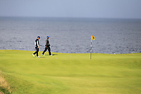Matt Wallace (ENG) and Tiger Woods (USA) on the 5th green during 1st round of the 148th Open Championship, Royal Portrush golf club, Portrush, Antrim, Northern Ireland. 18/07/2019.<br /> Picture Thos Caffrey / Golffile.ie<br /> <br /> All photo usage must carry mandatory copyright credit (© Golffile | Thos Caffrey)