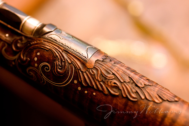 A close up shot of the detailed woodworking on one of Bobby Denton's hand made guns