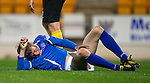 St Johnstone v Livingston...24.08.11   Scottish Communities League Cup Round 2.Murray Davidson lies injured after collding with Andrew McNeil.Picture by Graeme Hart..Copyright Perthshire Picture Agency.Tel: 01738 623350  Mobile: 07990 594431