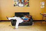 Ezzard McRae naps at Anytime Cutz Barbershop in North Atlanta, Georgia, July 23, 2013.