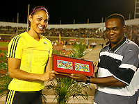 Cancice Davis accepting her award after placing 3rd. in the 100m hurdles with a time of 12.98sec. at the Jamaica International Invitational Meet on Saturday, May 2nd. 2009. Photo by Errol Anderson, The Sporting image.net