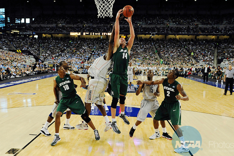 2009 APR 04: Goran Suton (14) of Michigan State University pulls down a rebound during the semifinal game of the 2009 NCAA Final Four Division I Men's Basketball championships held at Ford Field in Detroit, MI.  Michigan State defeated Connecticut 82-73 to advance to the championship game. Chris Steppig/NCAA Photos