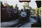 A head-on view of D&amp;RGW #340 passing the Knott's Berry Farm depot with D&amp;RGW box car #3350 on the next track.<br /> D&amp;RGW  Buena Park, CA  Taken by Dorman, Richard L. - 8/13/2003