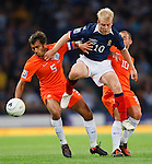 Steven Naismith mixes it up with Giovanni van Bronckhorst and Wesley Sneijder