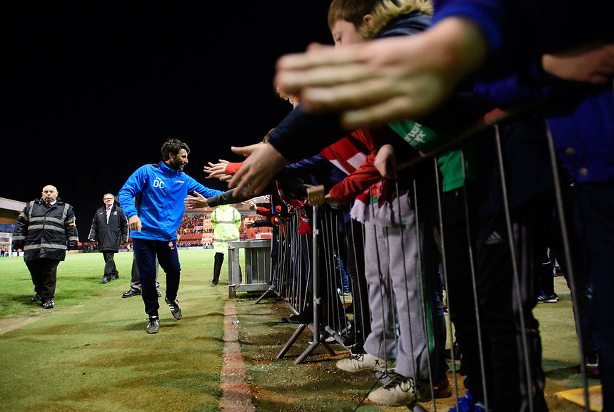 Lincoln City manager Danny Cowley celebrates the win with fans at the end of the game<br /> <br /> Photographer Chris Vaughan/CameraSport<br /> <br /> Vanarama National League - Lincoln City v Chester - Tuesday 11th April 2017 - Sincil Bank - Lincoln<br /> <br /> World Copyright &copy; 2017 CameraSport. All rights reserved. 43 Linden Ave. Countesthorpe. Leicester. England. LE8 5PG - Tel: +44 (0) 116 277 4147 - admin@camerasport.com - www.camerasport.com