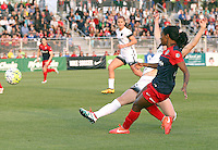 Boyds, MD - Saturday May 07, 2016: Washington Spirit forward Crystal Dunn (19) sends a cross past Portland Thorns FC midfielder Meleana Shim (6) during a regular season National Women's Soccer League (NWSL) match at Maureen Hendricks Field, Maryland SoccerPlex. Washington Spirit tied the Portland Thorns 0-0.
