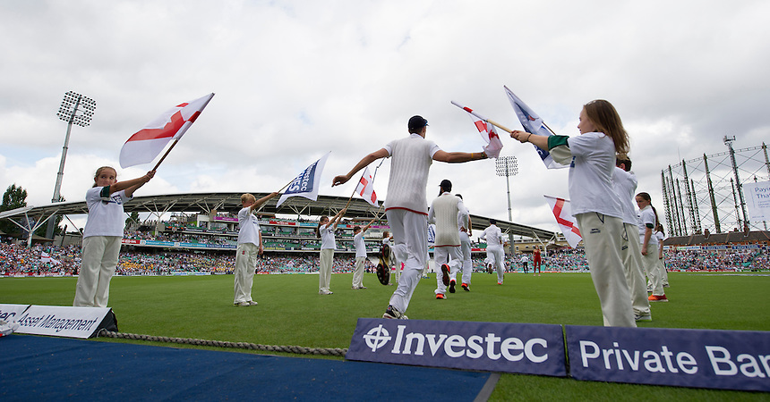England players come out onto the pitch on the 2nd day<br /> <br /> Photographer Ashley Western/CameraSport<br /> <br /> International Cricket - Investec Ashes Test Series 2015 - Fifth Test - England v Australia - Day 2 - Friday 21st August 2015 - Kennington Oval - London<br /> <br /> &copy; CameraSport - 43 Linden Ave. Countesthorpe. Leicester. England. LE8 5PG - Tel: +44 (0) 116 277 4147 - admin@camerasport.com - www.camerasport.com