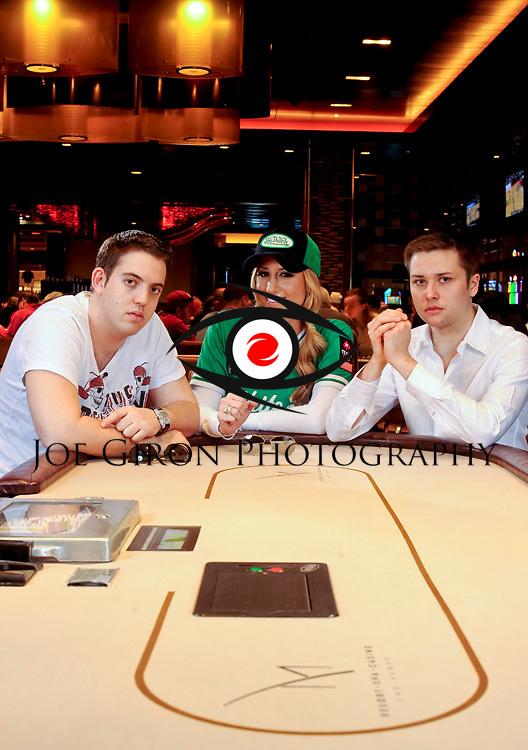 Poker professionals Luke Schwartz, Vanessa Rousso and Yevgeniy Timoshenko pose together for a portrait session.