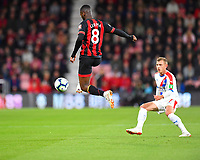 Jefferson Lerma of AFC Bournemouth controls the ball in mid air in front of Max Meyer of Crystal Palace during AFC Bournemouth vs Crystal Palace, Premier League Football at the Vitality Stadium on 1st October 2018